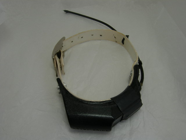 USED Quick Track Tracking Collar 220.005 on a White strap
